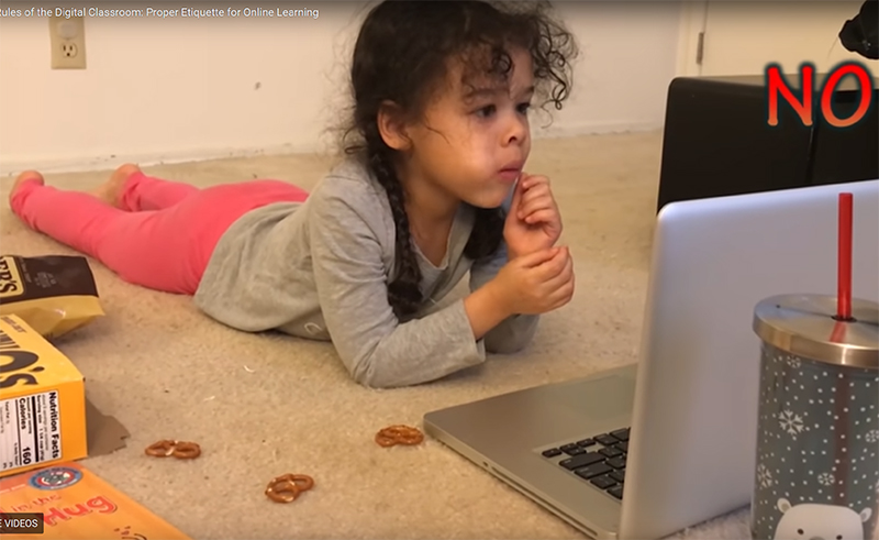 young girl doing school at home via Zoom
